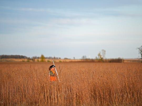 Jen Schaeffer, of Sioux Falls, walks a piece of cover