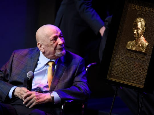 Fred Foster checks out his plaque as he was inducted in the Country Music Hall of Fame Medallion Ceremony Oct. 16, 2016.