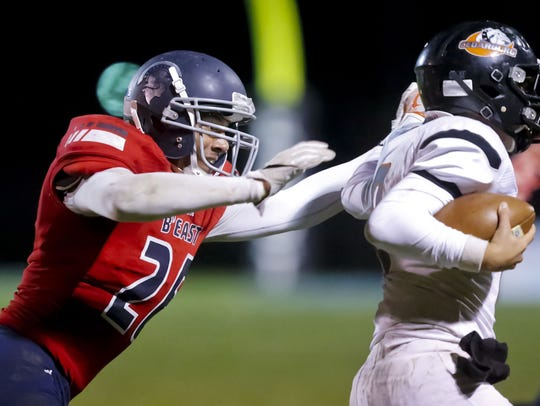 Brookfield East's Caleb Wright sacks Cedarburg quarterback