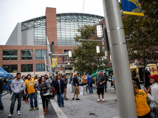 Georgia Street is a busy thoroughfare for fans and visitors before events at Bankers Life Fieldhouse, Lucas Oil Stadium and the Convention Center.