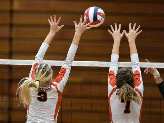 The Marshfield Tigers front row, makes a block against D.C. Everest in a Division 1 sectional semifinal at SPASH on Thursday night.