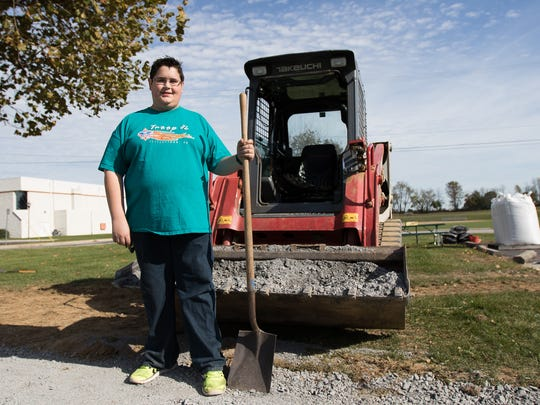 Boy Scout Travis Hartlaub poses for a portrait in Littlestown Community Park October 29, 2016. Several volunteers gathered in the park on Saturday to help Hartlaub construct a Veterans Memorial for his Eagle Scout Service Project.