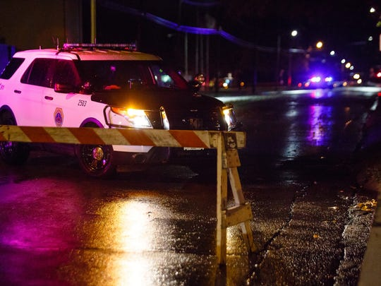 Police are shown at the scene where Des Moines Sgt. Anthony Beminio was ambushed on Nov. 2, 2016. Spokesmen for the public safety agencies involved say no communications snags delayed first responders the night Beminio and Urbandale officer Justin Martin were shot and killed. But metro officials acknowledge that communications glitches do happen in situations involving multiple police and fire departments and that even slight delays could put people and property at greater risk.