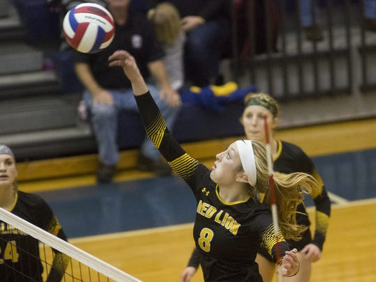 Red Lion's Logan Dontell, center, hits the ball. Red Lion defeats Hempfield 3-2 to win the District 3 Class 4A girls' volleyball championship at Dallastown Area High School, Saturday, November 5, 2015.