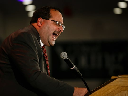 Chairman of the Republican Party of Iowa Chairman Jeff Kaufmann ramps up the crowd as election results come in during the election night party for the Republican Party of Iowa at the Marriott on Tuesday, Nov. 8, 2016 in downtown Des Moines.