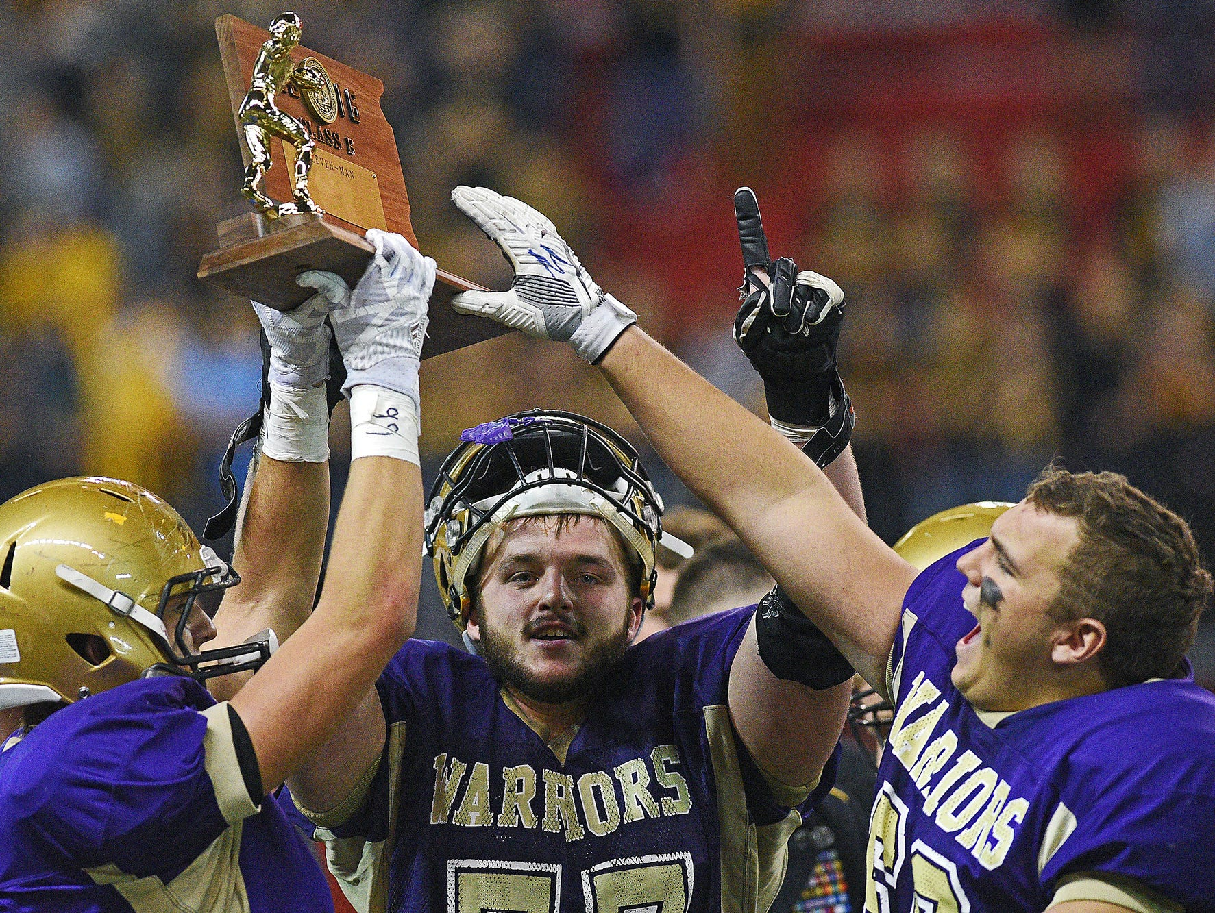 Winner players, including John Kludt (77), center, celebrate their 54-0 win over Groton Area in the 2016 South Dakota State Class 11B Football Championship game Friday, Nov. 11, 2016, at the DakotaDome on the University of South Dakota campus in Vermillion, S.D.