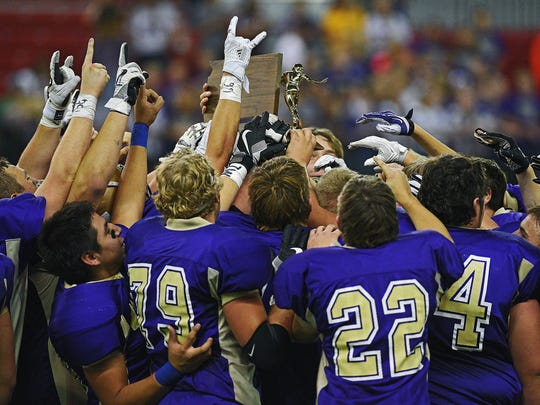 Winner players celebrate their 54-0 win over Groton Area in the 2016 South Dakota State Class 11B Football Championship game Friday, Nov. 11, 2016, at the DakotaDome on the University of South Dakota campus in Vermillion, S.D.