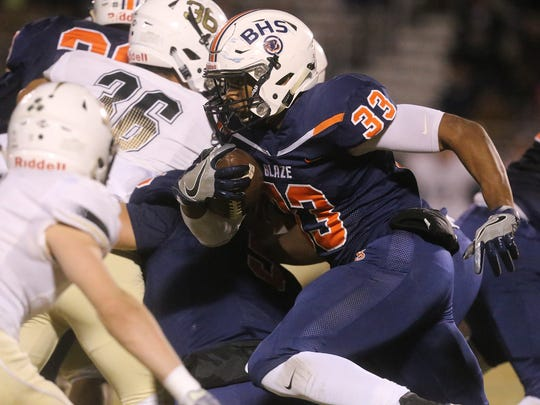 Balckman's Master Teague (33) runs the ball against Bradley Central on Friday, Nov. 11, 2016, during the second round of the TSSAA Football Play-Offs.