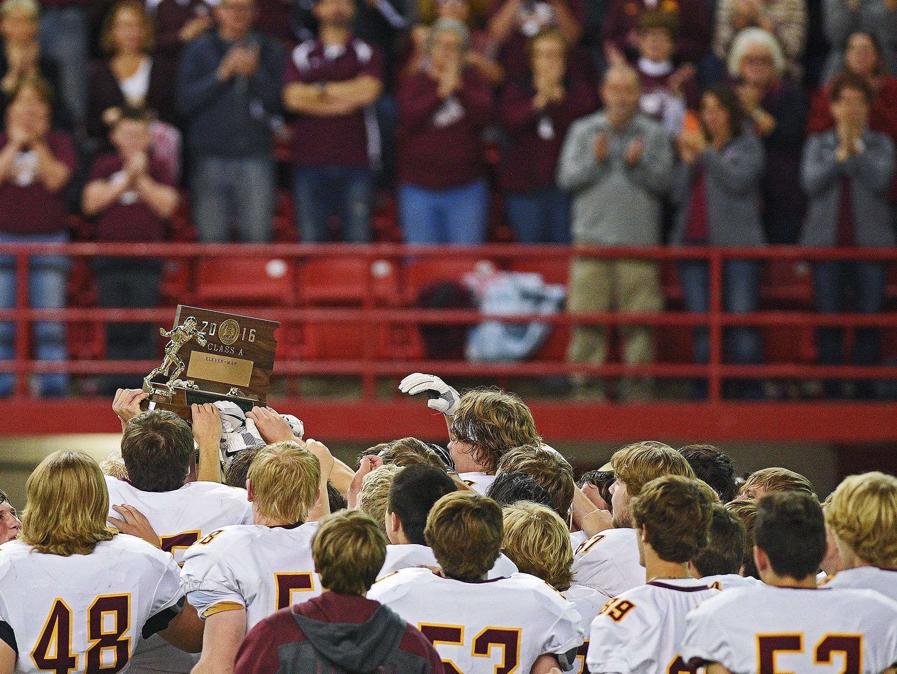 Madison players celebrate their 39-0 win over Tea Area in the 2016 South Dakota State Class 11A Football Championship game Saturday, Nov. 12, 2016, at the DakotaDome on the University of South Dakota campus in Vermillion, S.D.