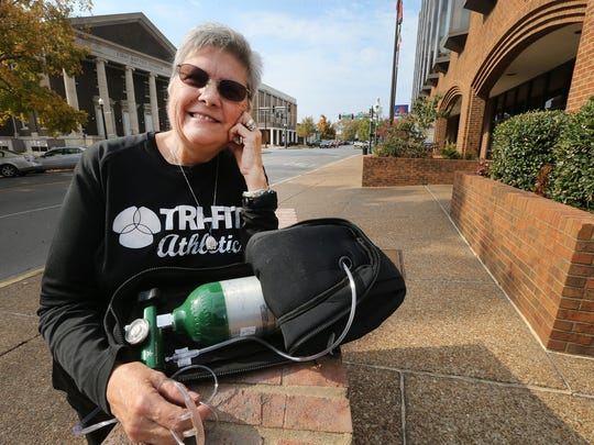 Linda Feagans, who has lost over 100 pounds and once had to run with this oxygen tank, will be running again in this year's Boro Dash.