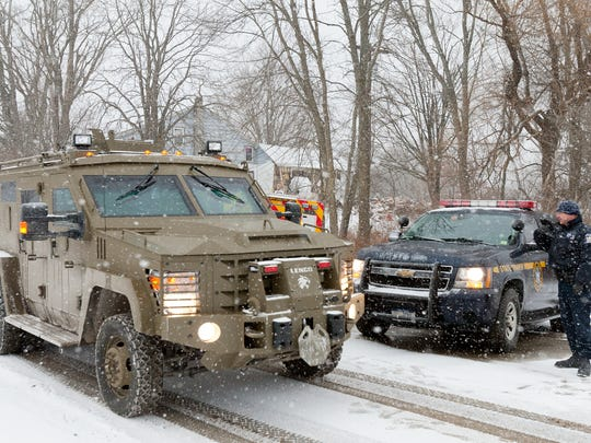 An armored vehicle departs Hornbrook Road near David