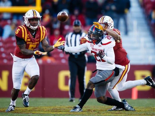 Iowa State's Kamari Cotton-Moya intercepts a pass and