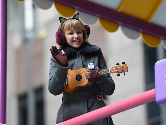 Grace VanderWaal rides the GoldieBlox float in the