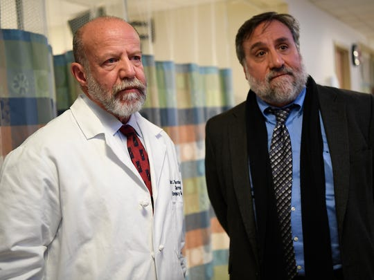 Dr. Mark Rosenberg, left, chairman of emergency medicine