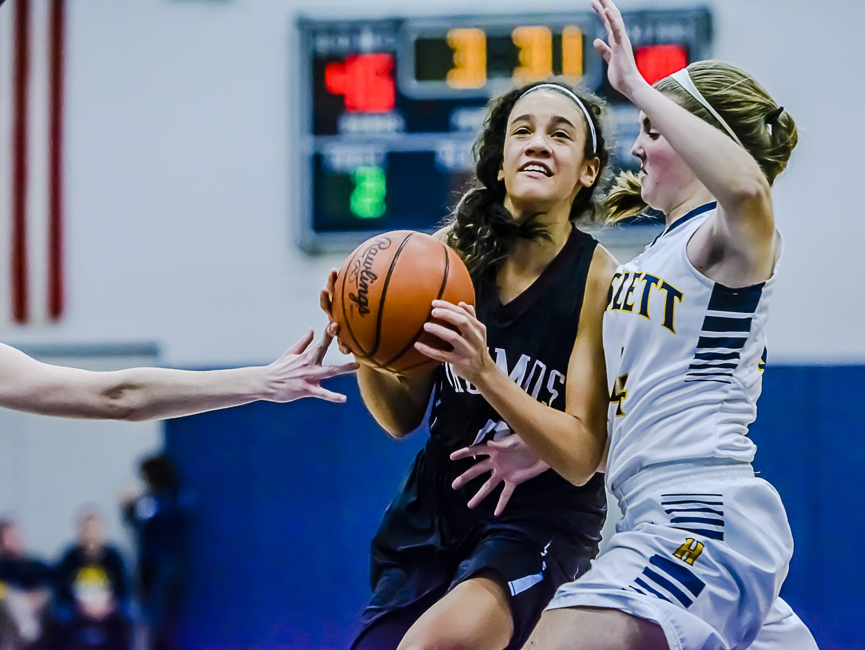 Okemos guard Laya Hartman, center, is rated one of the nation's top players in the 2019 class.