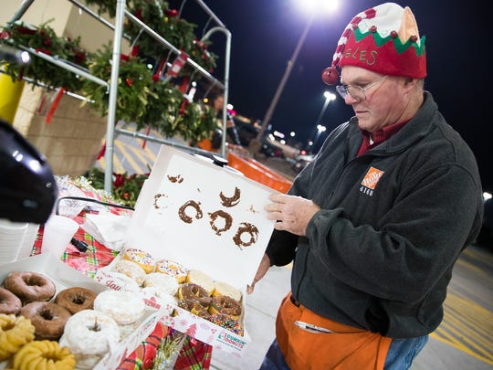 Howard Taylor of Littlestown prepares free doughnuts and coffee for Black Friday shoppers outside of Home Depot in Hanover on Nov. 25.