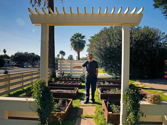 Chef Kevin Binkley in his fresh herb garden at his