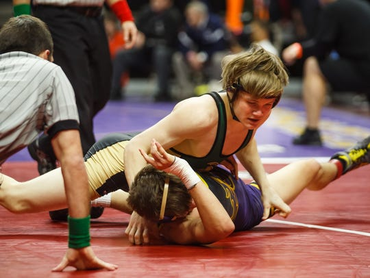 Iowa City-West's Nelson Brands wrestles Johnston's