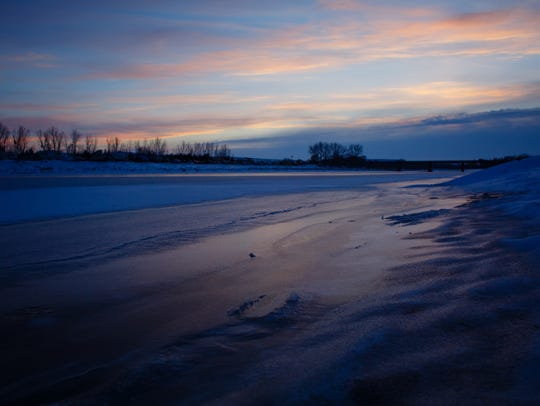 The Cannonball River is nearly frozen over next to