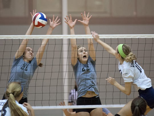West York's Kate Tate gets blocked by York Suburban's