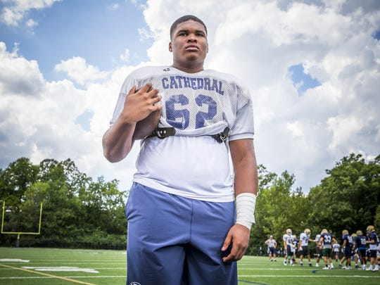 Cathedral offensive lineman Emil Ekiyor has committed to Michigan.