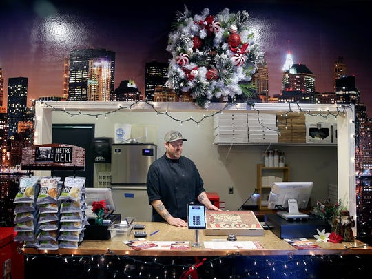 Trendy's Pizzeria in Keyport  kitchen manager and chef Alex Blanchard at the festive from window on Wednesday, December 7, 2016.  The pizzeria is in the old Whiskey Creek Steakhouse location.
