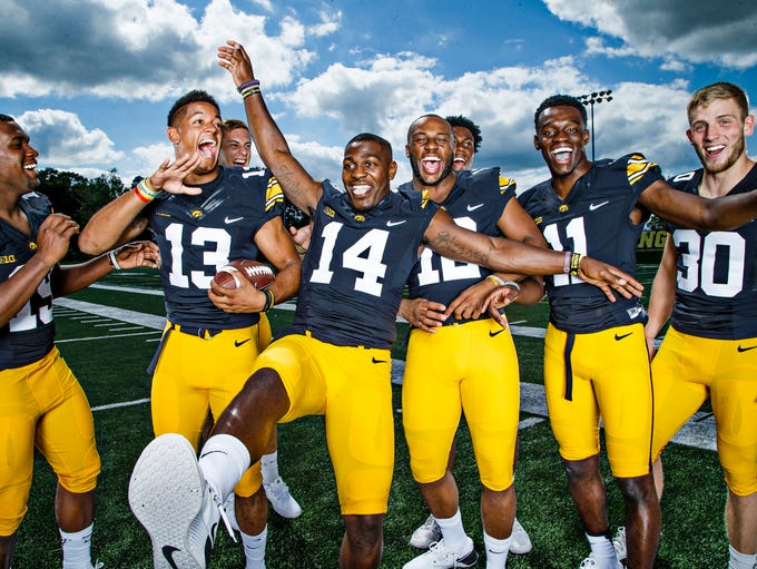 The Hawkeyes defensive backs pose for a portrait during