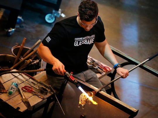 Corning Museum of Glass gaffer Tom Ryder adds heat