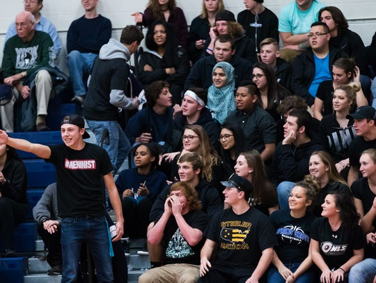 The Spring Grove student section cheers on their team