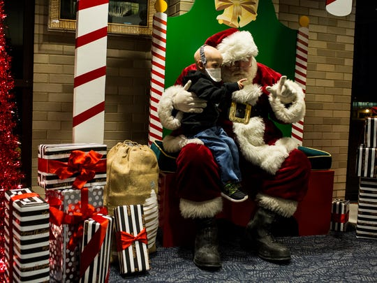 "December 20, 2016 - Isaac Randolph, 3, talks with Santa Claus after the ""Fantasy Flight to the North Pole."""