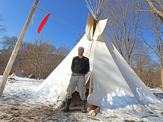 Owl Smith of Hillburn, N.Y., a member of the Ramapough Lenape Nation, keeping the fires burning at the camp. Other tribal members sometimes gather there and stay in tepees and other shelters.