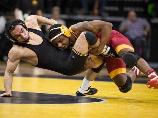 John Meeks (right) is one of three wrestlers at 141 pounds that Iowa State plans to take to this week's Midlands Championships.