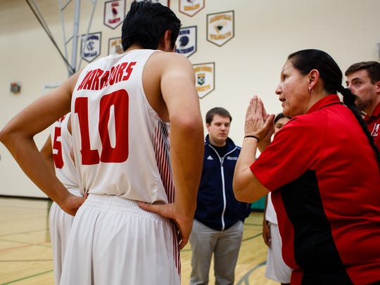 "Meskwaki boys' basketball coach Dina Keahna is the only female varsity coach in the state. Her goal she said is to teach the boys life skills through the sport and, ""do the the little things and let the score take care of itself."" Here she coaches the team during a game at home on Monday, Dec. 19, 2016, in Tama."