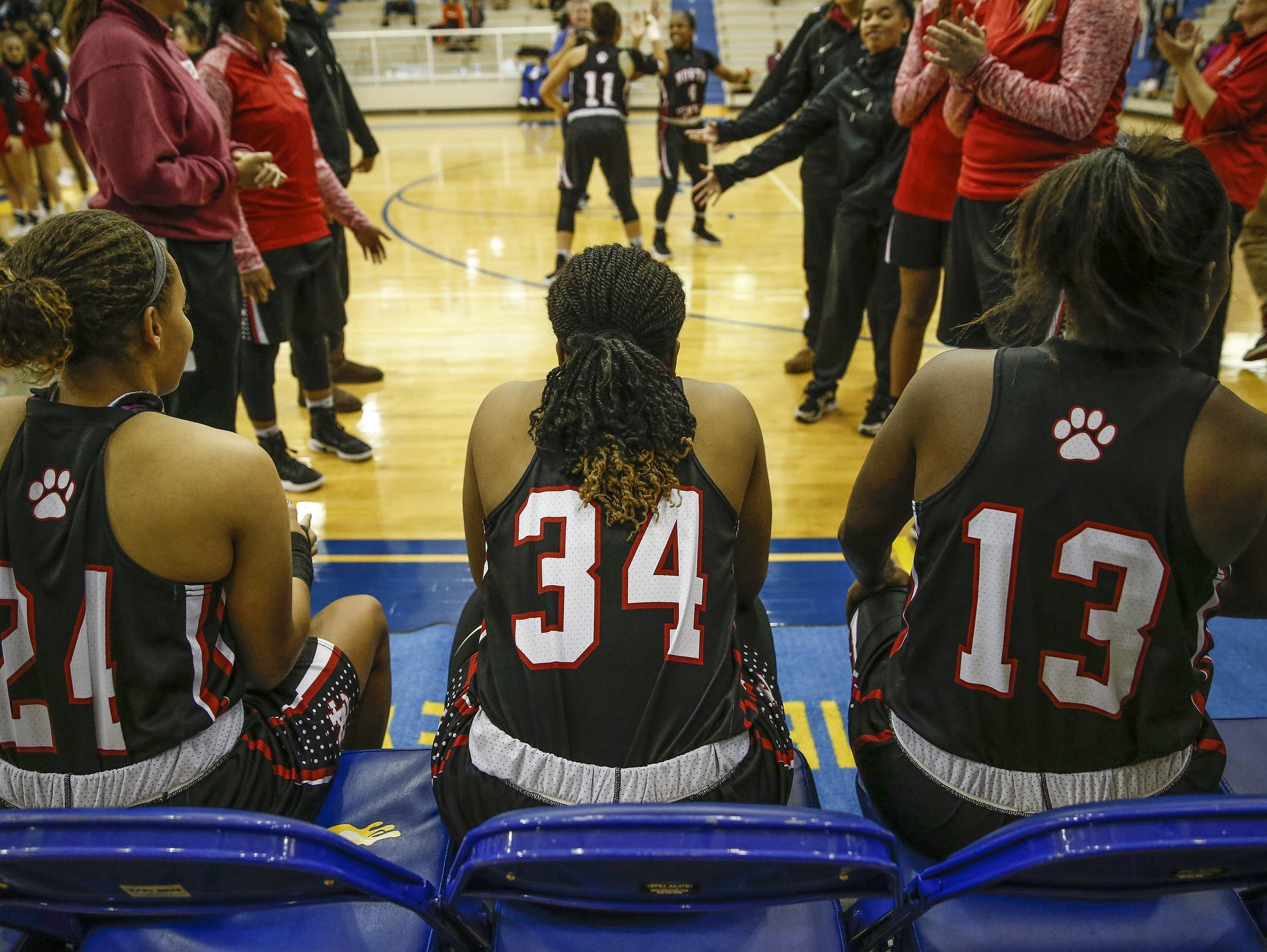 North Central Panthers' Ajanae' Thomas (34) waits to be introduced before the Panthers' game against the Carmel on Dec. 16, 2016. Thomas wears the number 34 in honor of her late mother Nicole.