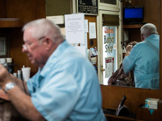 Bob Young, of Hanover, cuts the hair of his son, Fred Young, on his last day at Weaver's Barbershop in Hanover.