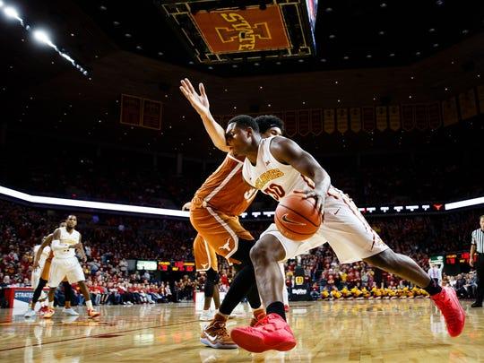 Iowa State's Deonte Burton dribbles past Texas's Jarrett