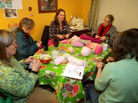 Hats are knitted as part of the Pussyhat project ahead of the Women's March. Taking part are, from bottom left, Tami Allen, Dale Walker, Catherine Purves, Marsha Cutting and Claudette Boudreaux.