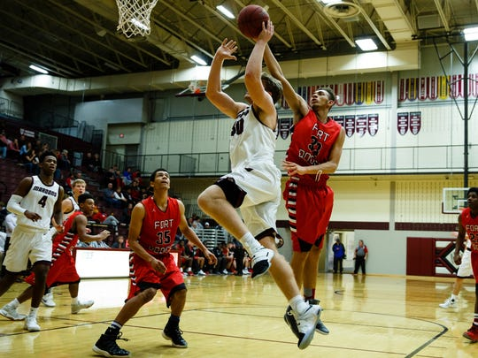 Fort Dodge's Jordan Jackson tries to block the shot of Dowling Catholic's John Waggoner during their game at Dowling Catholic on Saturday, Jan. 14, 2017, in West Des Moines. Dowling Catholic would go on to win 70-35.