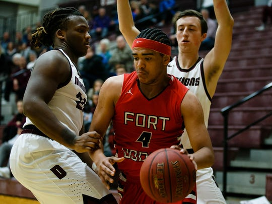 Fort Dodge's Edker Foy tries to get around Dowling Catholic's Atlias Bell during their game at Dowling Catholic on Saturday, Jan. 14, 2017, in West Des Moines. Dowling Catholic would go on to win 70-35.
