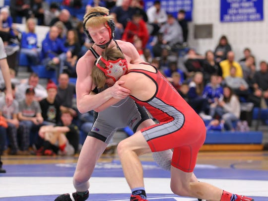 Elmira's Noah Carpenter battles with Chenango Valley's Derek Goga in the 132-pound weight class during Saturday's STAC Championships.