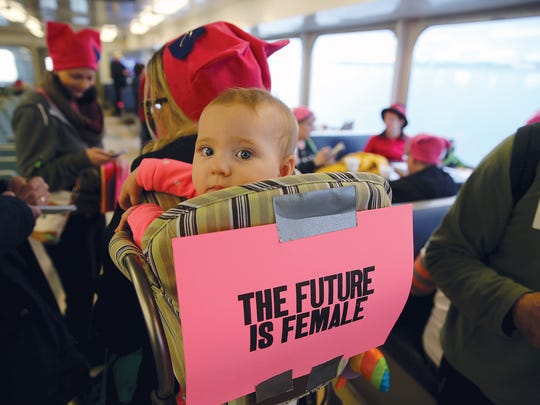 Lily Meehan, 10 months, goes on the ferry with her