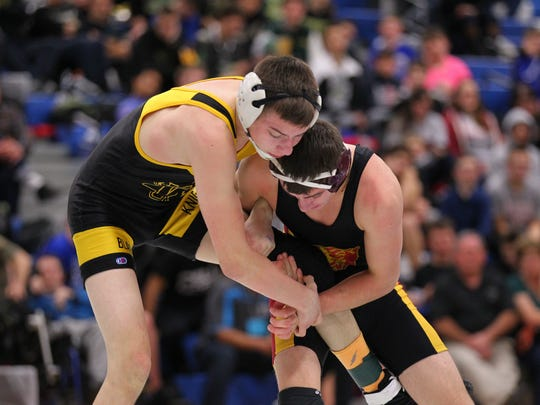 """Windsor senior Corey Swartz, left, said if he doesn't eat a lot before a match he feels like """"absolute garbage."""""""
