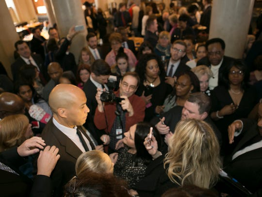 U.S. Senator Cory Booker talks to the press and admirers