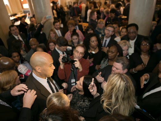 U.S. Senator Cory Booker talks to the press and admirers after the announcement. U.S. Senator Cory Booker joins Mayor Tim Dougherty as he kicks off his third campaign for mayor. Dougherty will be running in the June Democratic primary election with a slate of Town Council candidates. The event took place at Jockey Hollow Bar and Kitchen, Morristown, NJ. Monday, Jan. 23, 2017. Special to NJ Press Media/Karen Mancinelli/Daily Record