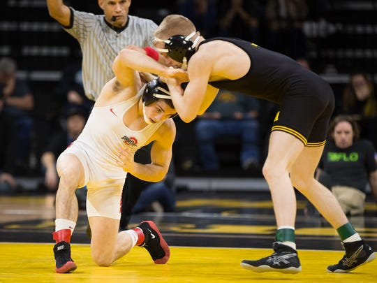 Iowa junior Phillip Laux grapples with Ohio State junior Nathan Tomasello in a  133-pound match at Carver Hawkeye Arena in Iowa City on Friday, January 27, 2017.