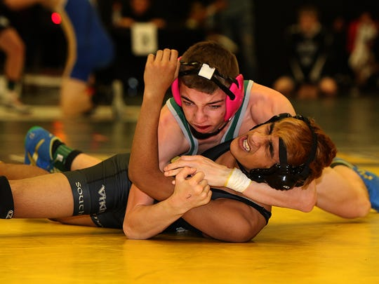 J. F. Kennedy's Ian Coleman (top) and South Brunswick's Arjun Khatir wrestle at 113 pounds at the GMC Tournament on Friday at Piscataway High School.