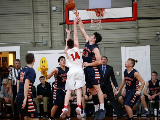 Bobby Dearing of Harrison blocks a shot by Ty Williams of Southmont in the Husker Classic at the Hoosier Gym Saturday, January 28, 2017, in Knightstown. Harrison pounded Southmont 96-70.