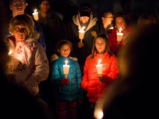 In this file photo from Jan. 29, 2017, Gracie Bixler, 9, center left, attends a candlelight vigil to honor the memory of Diana Ziegler, 25, of Jackson Township, and her unborn child.