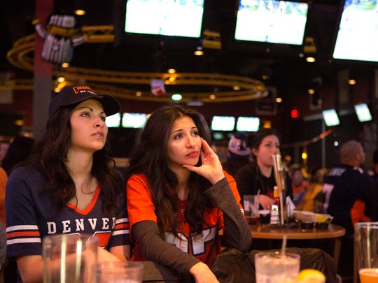 Disgruntled Denver Broncos fans Laura, left, and Sara Jaques watch the Super Bowl until the bitter end at Buffalo Wild Wings in Fort Collins Sunday, Feb. 2, 2014. Denver lost to the Seattle Seahawks 43-8.