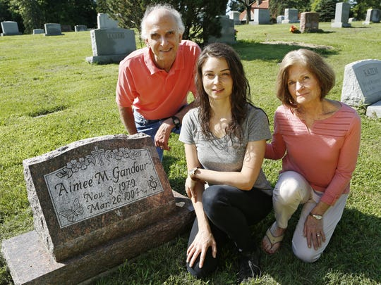 After Molly Gandour (center) began talking with her family about grieving her sister Aimee Gandour, Mary Jane Gandour (right) began writing. The girls' father, Jack Gandour, is at left.